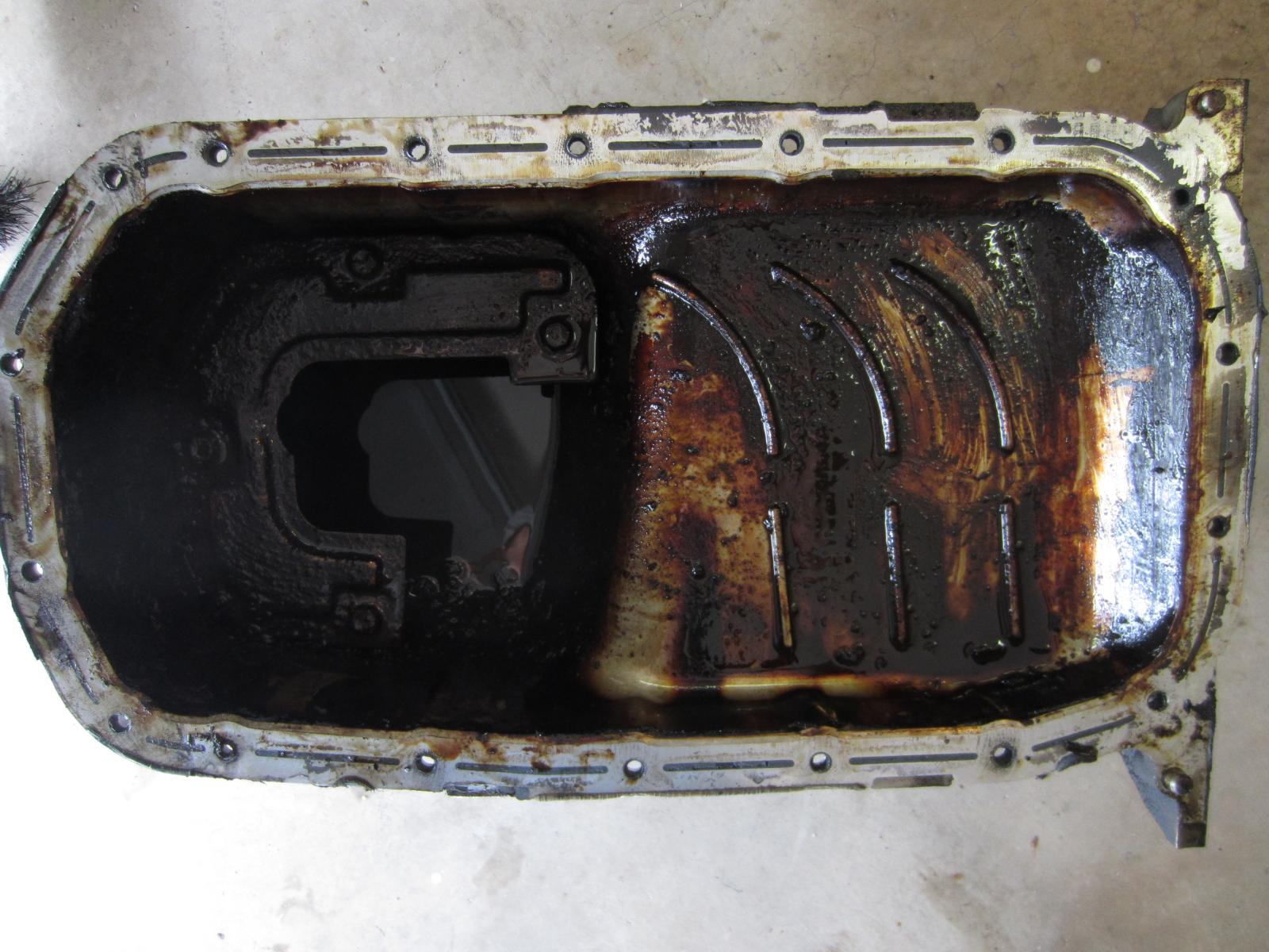 how to clean sludge in engine